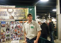 Aaron manning the booth at sportshow